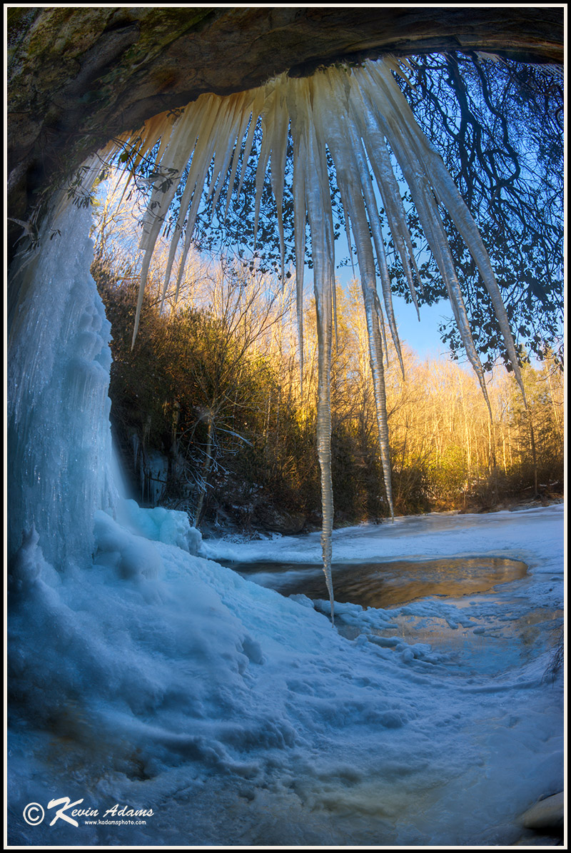 Early morning fisheye winter view from behind a waterfall in North Carolina's Nantahala National Forest.